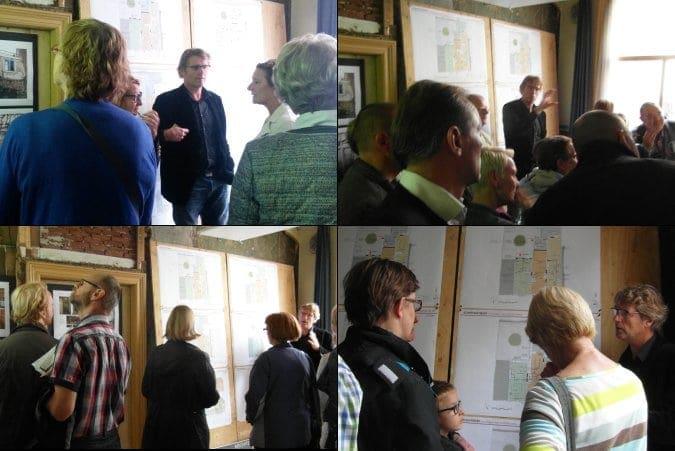Architect Marcel van Dijk geeft uitleg aan bezoekers.